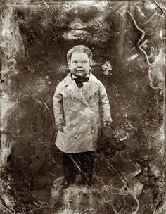 """Tom Thumb, full-length portrait, facing front, standing on table."" Half-plate daguerreotype c. 1850-55 from the studio of Mathew Brady"