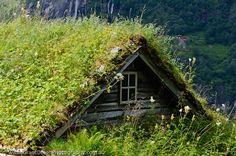 NORWAY, Northern fjords, Geirangerfjord. Skagefla abandoned mountain farm, with turf-roofed buildings. Geirangerfjord is part of the Unesco-listed Western Fjords World Heritage site. (c) GrantDixonPhotography.com.au