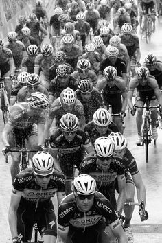 For the love of #cycling - The Quickstep Omega Pharma squad guides the peloton through a rainy stage of the 2014 Giro d'Italia