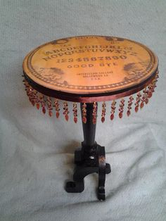 Ouija board side table,with beaded edges