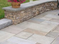 New England fieldstone wall with bluestone cap and bluestone patio
