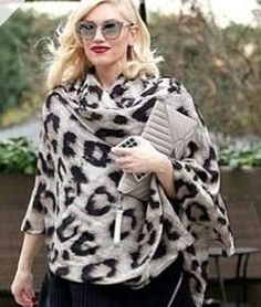 Gwen rocks the scarf-as-coat look.