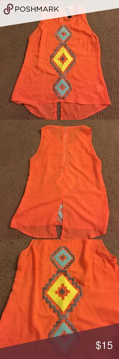 Aztec tank Orange Aztec print tank with zipper up the back from Francesca's! Brand is Blue Rain size medium. Only worn once, great condition! Like new Francesca's Collections Tops Tank Tops