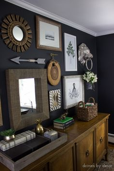 Home office gallery wall on dark charcoal walls