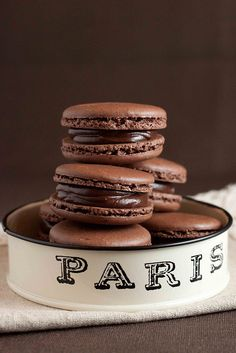 French Chocolate Macarons with Chocolate Ganache Recipe. Made the ganache only. Used toasted marshmellow macaron recipe for the cookie but subbed of the powder sugar with cocoa powder. Chocolate Macaroons, Chocolate Ganache, Chocolate Desserts, White Chocolate, French Macaroons, French Chocolate Macarons Recipe, Chocolate Cookies, Chocolate Pancakes, Chocolate Biscuits