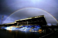 A rainbow over the stands at a flooded Gay Meadow, home of Shrewsbury Town, in December 2000.
