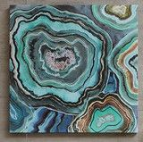Cut agate stones, known for their alluring beautiful circular ring patterns, are captured in this abstract canvas artwork. Featuring sliced rocks in stunning aqua, green, gray, and blues and imagined