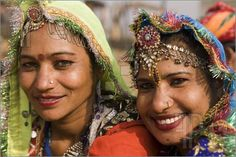 Picture of Portrait of two tribal dancers from the Kota district of Rajasthan, India