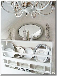 painted white chandelier ... plate rack ... lovely figurines ... soft and lovely