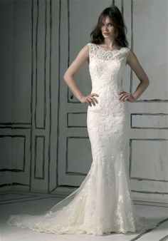 all about hiding a few spots... and comes in ivory... simple and feminine... and detachable train...