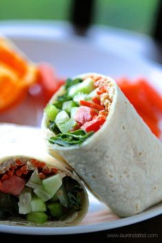 Hummus and Veggie Wraps from www.laurenslatest.com . This recipe is nutritious and delicious. Quick and easy to make. #laurenslatest #healthymeals #veggiewraps #hummus