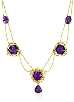 An Art Nouveau amethyst and gold necklace, compose of three hexagonal-cut amethysts with two bezel set amethysts on a two row festoon chain, in 14k. Circa 1900.