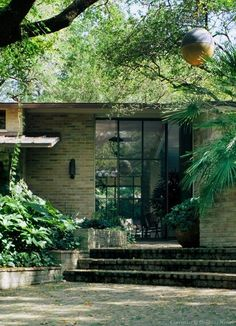 O'Neil Ford Designed Mid-Century Modern Home | light brown brick walls + stone steps
