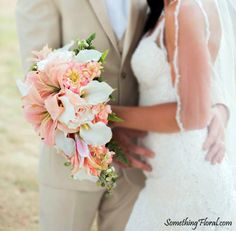 Pretty bellini (blush), pink, peach, white, ivory, and green cascade bridal bouquet featuring high quality, realistic faux lilies, calla lilies, zinnias, roses, delphinium, and fern. Floral Design: Something Floral / Something Spectacular.