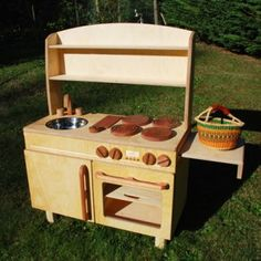Wooden play kitchen I love the natural look.  I can add colorful accessories!