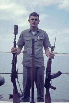 A sailor displays three weapons: (L-R) Mosin Nagant (or variation of) with what is potentially a grenade launcher attached, an RPG, an AK-47. (Source: pbrcaptain.com)