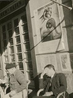 Margaret MICHAELIS Austria 1902 – Australia 1985 Movements: Australia from 1939 No title [Man sitting under poster 'Partido Sindicalist'] c.1936-37 gelatin silver photograph (semi-glossy paper) image 7.8 h x 5.8 w cm  Gift of the estate of Margaret Michaelis-Sachs 1986 Accession No: NGA 86.1384.406