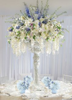 design by Preston Bailey. I like the blue delphiniums.