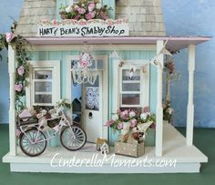 I made a shop/shop keeper's cottage for Jen. It's called Hart and Bear's Shabby Shop. I made this house entirely by hand. No kit. I use woo...