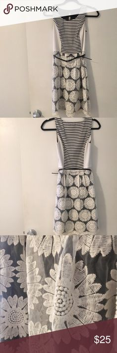 Kensie sleeveless black and white sunflower dress Kensie, XS, bodice is 97% polyester 3% spandex , skirt is 95% cotton 5% rayon; comes with belt Good Condition worn a few times. Perfect for spring! Kensie Dresses