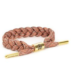 Accent any outfit with the Rastaclat Sundown Bracelet. Made with a braided shoelace in a Brown and Orange colorway for a comfortable and stylish wear, this bracelet has a Gold adjustable metal cylinder sizing piece with a debossed Rastaclat logo and Gold