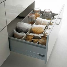 Another take on drawer dry goods storage.  Like that the cereal doesn't have to be transferred into another container.