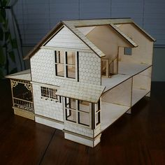 """½"""" scale Crockett House Victorian Style Dollhouse Kit, crafted from laser-cut 1/8"""" Baltic birch plywood  Modeled after a historic home in"""
