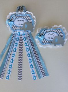 Boy elephant baby shower corsage set/ Mommy to e and Daddy to be corsage set/Blue and grey baby shower corsage/Blue and grey chevron corsage by InspiredbyElena on Etsy https://www.etsy.com/listing/269969259/boy-elephant-baby-shower-corsage-set