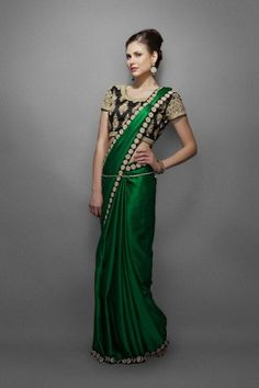 Indian designer sarees, party wear sarees- This emerald designer green sari comes with an elegant border and a heavy designer blouse.