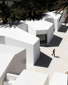 taken from above the stark white volumes belong to the santa marta lighthouse museum by aire mateus in #cascais portugal. see more projects by #airesmateus on #designboom! #architecture #minimalarchitecture by designboom