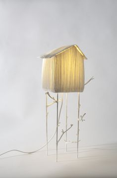 sculptures_lumineuses - papier à êtres. This delicate little luminary is a delightful design touch. An illuminated objet d'art that makes a heartwarming substitute for a regular old lamp!