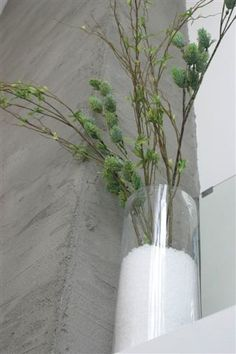 winter decor: vase of branches with faux snow.
