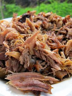 Kalua Pork - pork, hawaiian sea salt & liquid smoke flavoring. Cook 16-20 hrs on low in crock pot. I've made this before. Delish!