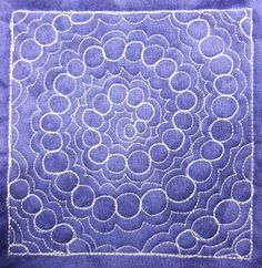 Bubble Path Spiral is a challenging free motion quilting design, but you can make it much easier for yourself by marking the spiral shape on your quilt before starting the circles. Learn to stitch it at http://freemotionquilting.blogspot.com/2010/06/day-196-bubble-path-spiral.html
