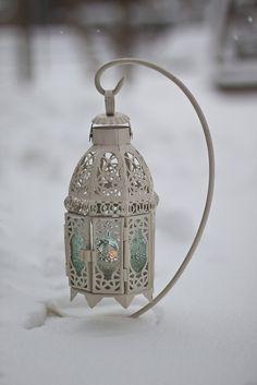 lantern in the snow by Pbeckerphoto, via Flickr