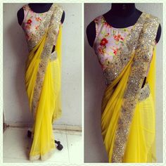 Ready for some summer love! Gorgeous yellow net sari with mirror work embelishments and a pure silk printed floral blouse.