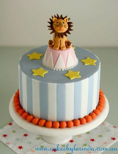 Make a few cakes topped with different animals or clowns. With red and white instead