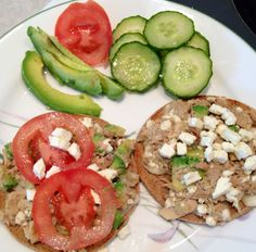 Mix one small can of white tuna w/ 2 tbls. cottage cheese, a splash of balsamic vinegar, and 1/4 of a diced avocado. Place thinly sliced mozzarella on each side of one whole wheat sandwich thin, add tuna mix to open faced bread and place in oven on broil until cheese is melted and tuna is warm. Top with crumbled feta, tomatoes, or whatever you desire. Super delicious!