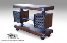 This rustic industrial wine bar/buffet table is a welcome addition to warm up your dining room or bar. Featuring a heart pine top inlaid into dark stained surround, it will be a wonderful statement piece. Expanded metal makes up the center shelving and two cabinet drawers for
