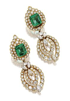 PAIR OF EMERALD AND DIAMOND PENDANT-EARCLIPS, VAN CLEEF & ARPELS, NEW YORK , 1974.  The tops set with 2 emerald-cut emeralds weighing approximately 5.10 and  5.15 carats respectively, within flame-shaped borders set with 66 round diamonds, supporting navette-shaped swing pendants set with 56 round and 8 marquise-shaped diamonds, the total diamond weight approximately 14.50 carats, mounted in 18 karat gold, signed Van Cleef & Arpels, numbered N.Y. 2500 S.O., pendants detachable.