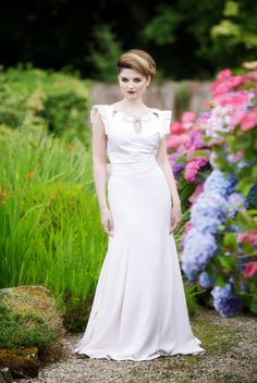 From Jen Doherty, bridal wear designer, Donegal, a winter white  Duchesse Satin bodice with ruching and jewel stones detail on the scoop neckline. The princess line skirt, made from silk crepe, falls into a lovely puddle train.  See more at: http://www.jendoherty.com #couture #Donegal #bridal wear
