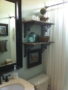 Shelf brackets from hobby lobby and reclaimed wood.  Easy do-it-yourself project.