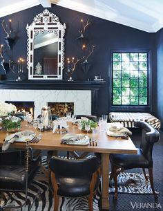 The designer calls everyone to the kitchen by cheerily ringing sleigh bells that are brought out for the season. She sets the food on the kitchen's farmhouse table buffet-style