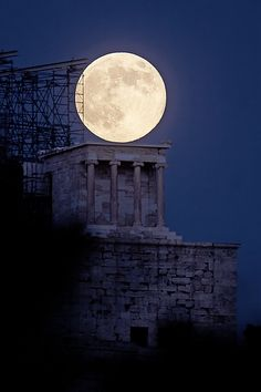 July 2013's full moon rising against the Temple of Athena Nike (427-424 BC) at the Acropolis of Athens. Full Moon Rising Over The Temple of Athena by Anthony Ayiomamitis