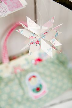 paper origami star decoration (I have this paper AND the book with the pattern. Why have I not made this before!?)