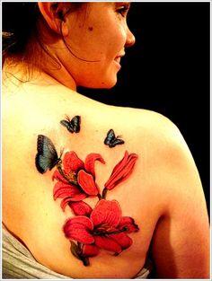 Dessin orchidée et papillon sur l'épaule https://tattoo.egrafla.fr/2016/02/11/tatouage-orchidee/