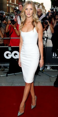 Rosie Huntington-Whiteley looked white-hot in a crisp Versace LWD with metallic straps, matching them with silver python Christian Louboutin pumps.