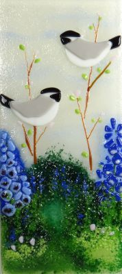 """Spring Chickadees, 6"""" x 13"""" Fused glass tile can be hung on the wall. Can also be made to inset into a tiled application. Jessy Carrara, Artist www.lightgarden.net $75"""