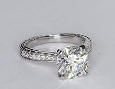 Inspired by vintage design, this diamond engagement ring in platinum features milgrained edges that frame an engraved motif set with petite round diamonds to frame your center diamond. Setting includes 1/10 carat total diamond weight. #bluenile