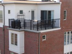 Duradek and Durarail rooftop terrace on a  Kendall Square townhome by Stanley Martin